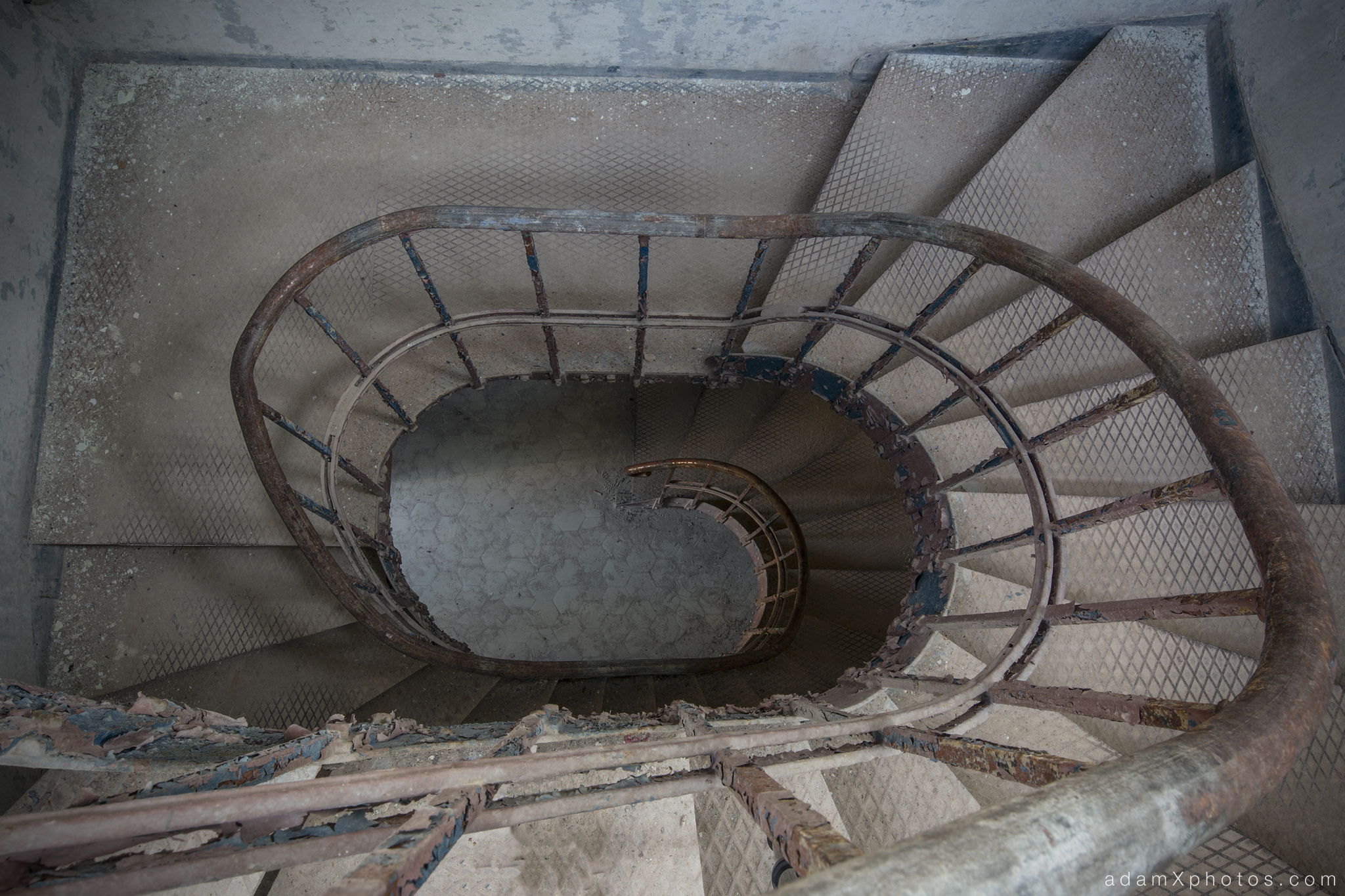Adam X Urbex Beelitz Heilstatten Germany Urban Exploration Mens Men's Bathhouse Bath House Hospital Decay Lost Abandoned Hidden stairs staircase spiral looking down