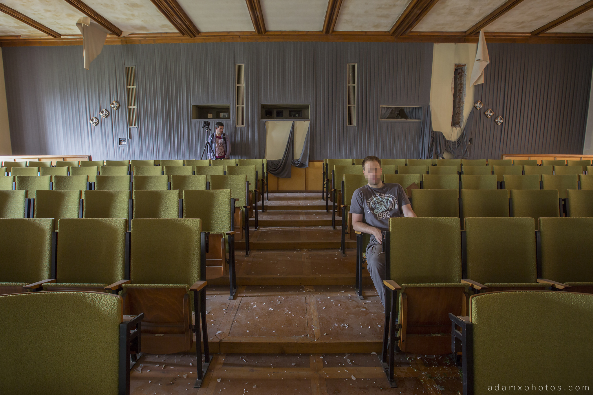 Adam X Urbex Nazi School Partishule N DDR Horsaal Germany Urban Exploration Decay Lost Abandoned auditorium ceiling seats chairs stage selfie James Kerwin