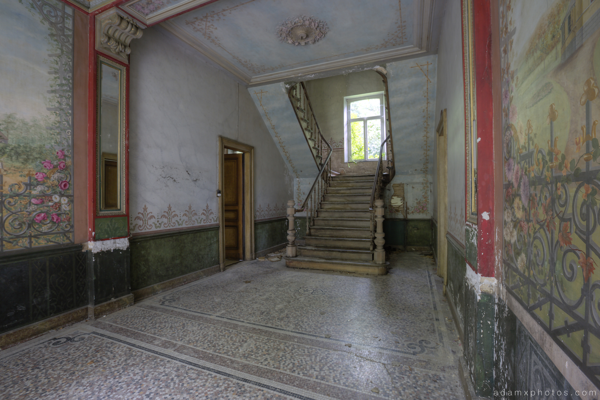 Downstairs hallway stairs staircase bannisters curved paintings painted Adam X Urbex UE Urban Exploration Belgium Chateau d'Ah house maison villa townhouse abandoned derelict unused empty disused decay decayed decaying grimy grime